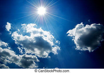 Blue Sky with Clouds - Cloudscape with bright sun and blue...