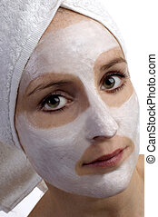 mask - young woman with beauty mask on white
