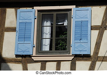 Blue Shutters - A window with blue shutters at a house in...