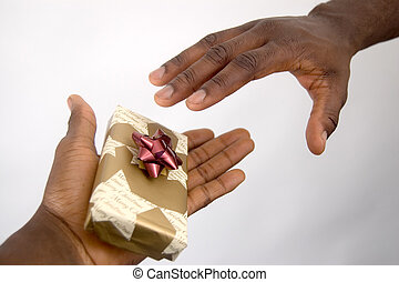 Christmas Giving - This is an image of a hand offering a...