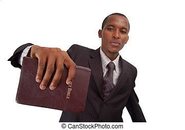 The Message - This is an image of man holding a bible. This...
