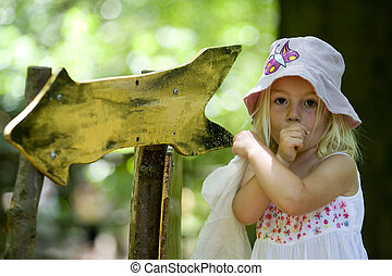 Pointing The Way - A cute little blonde girl wondering which...