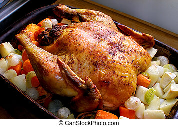 Roasted Chicken - Whole roasted chicken with vegetables in...
