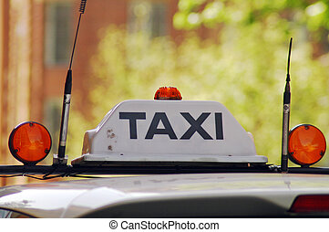 taxi taxi - detail photo of taxi sign on a taxi roof