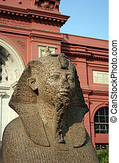The Egyptian Museum - Cairo - A statue of a pharoah stands...