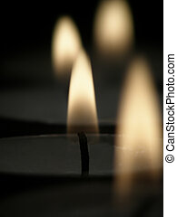 candle light - Close-up of candle light with black...