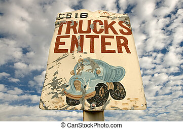 Truck Enterance - Monster cartoon on a sign for trucks to...