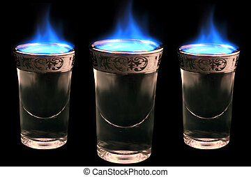 flaming drinks - shot glasses with alcohol on fire........