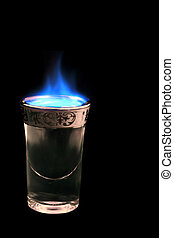 flaming drink - shot glass with alcohol on fire..... (drink...