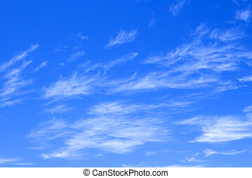 Blue Sky with Delicate Clouds - A deep blue sky with...