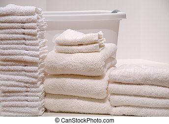Laundry Day - Folded washcloths and towels stacked up on...