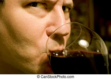 Attractive, Serious Man Drinking Wine - Photo of a serious,...