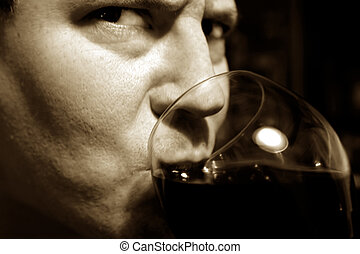 Attractive, Serious Man Drinking Wine