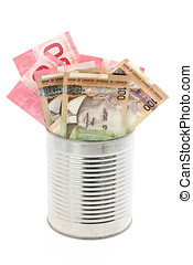canadian dollars and tin, concept of making money, or money...