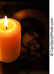 Candle in front of virgin Mary - Closeup of beeswax candle...
