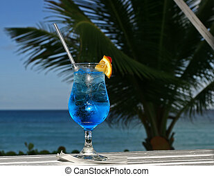 blue cocktail - a blue cocktail in paradise