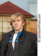 Young man in village October 2006 Novosibirsk area