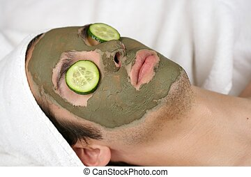 Mask III - someone having a mask in a spa with cucumber...
