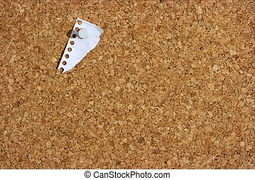 Pinboard - A torn fragmnt of white paper pinned to a board