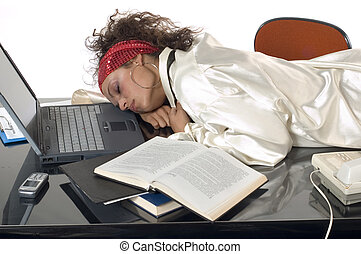 Dreaming at work - Businesswoman sleeping at work