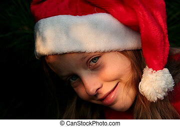 Christmas girl - Portrait of a young girl wearing Santa...
