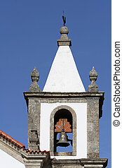 Belfry of the old, white church. Picture taken in Portugal