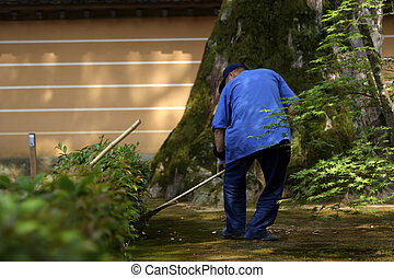 Gardener wearing blue uniform at work Picture taken in Kyoto...