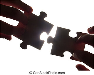 ready for contact - two hands trying to fit puzzle pieces,...