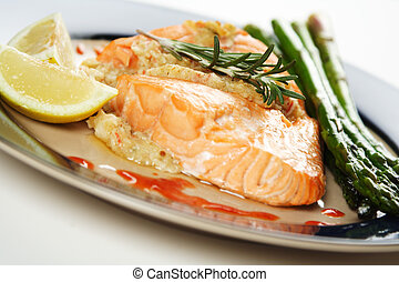 Baked salmon - A baked stuffed salmon with asparagus on the...