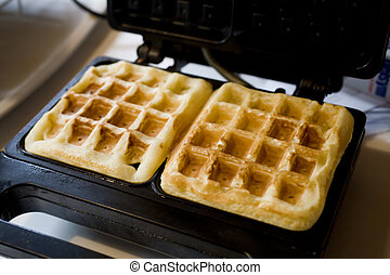 Making Belgian Waffles - Photo of two Belgian waffles in a...