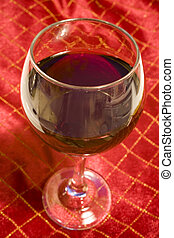 Wine Glass on Red Christmas Tablecloth - Photo of wine glass...