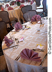 wedding tables set for fine dining during an event with...