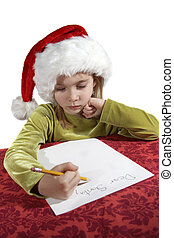 Christmas wish list - A young girl child writing her wish...