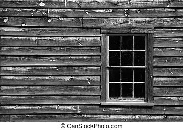 Window on old house, black and white,