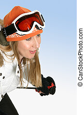 Downhill skier - A female wearing warm ski clothing skiing -...