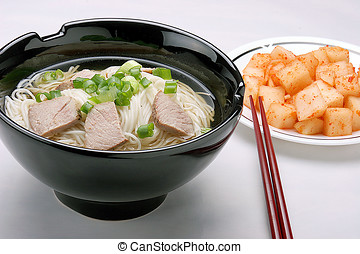 Korean noodles. - Korean noodles with a side dish of radish...