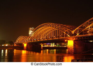Bridge at Night - Hohenzollen bridge spanning the river...