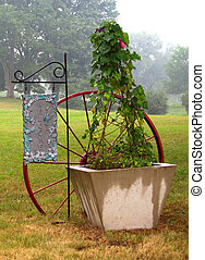 Welcome Sign - Welcome sign with wagon wheel and ivy on a...