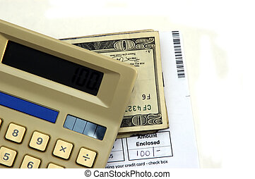 Paying Bills - Calculator, bill, pen and cash against a...