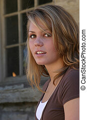 Brown eyed girl - blonde teen with brown eyes waiting...