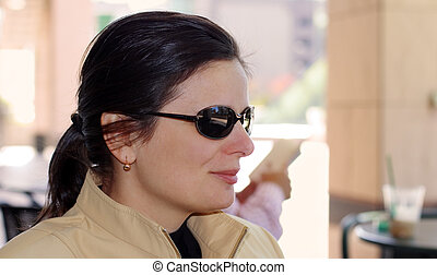 Woman at the terrace - Casual woman with sunglasses at the...