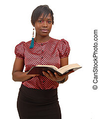 Focussed - This is an image of a woman posing with a bible.