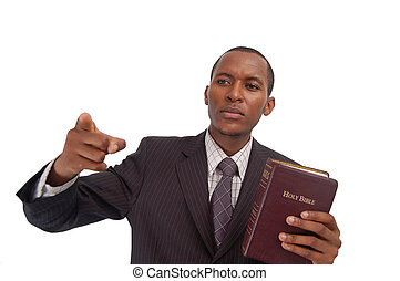 The Preacher - This is an image of man holding a bible This...