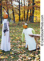 Pumpkin people outside during fall