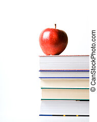 Books - red apple on top of stack of books for school