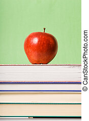 School time - apple sitting on top of books cnter...