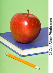 School time - blue book with red apple and pencil