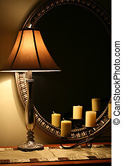 Elegant Lamp and Mirror - A cozy interior still life with...