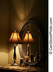 Elegant Lamp and Mirror on Table - A cozy interior still...