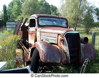 Rusty old truck - rusty old antique truck abandoned in...